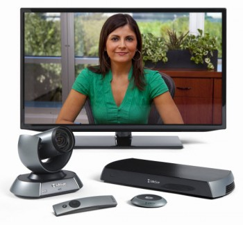 LifeSize ICON with lady in green top on screen. Displayed with LifeSize camera, micpod, icon codec and remote control.