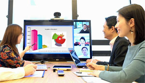 Screen in video conference showing meeting space and graphs