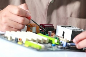 Close up circuit board and man making components