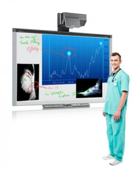 SMART board showing xrays and medical information with doctor stood in front