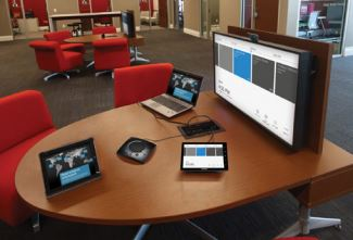 Crestron RL 2 on desk in small meeting space