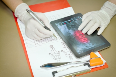 Doctor views patient results on tablet remotely.