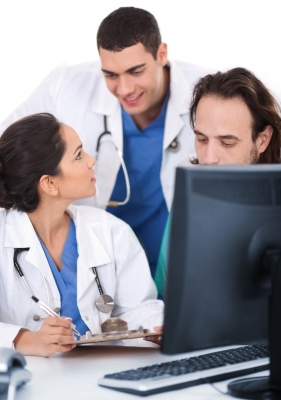 Doctors by computer screens