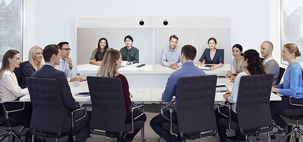 Cisco MX700 Video Conferencing Systems in meeting room with 10 people and 4 remote participants