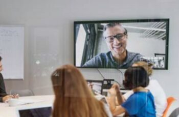 8x8 Video Meetings through glass in Huddle Room
