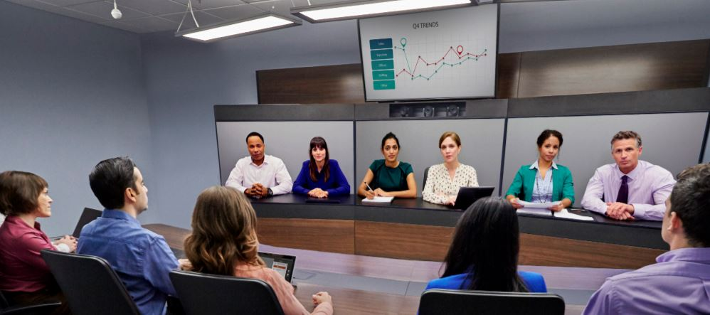 Polycom Immersive Studio Flex with 12 people in conference, 3 screens and data