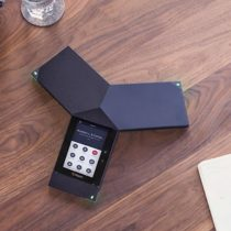 Polycom RealPresence Trio Voice and Audio device in centre of table